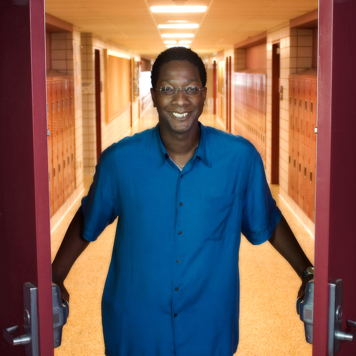 Anthony Parker, principal at Anthony Parker, the  Weston High School principal opening doors with hallway behind him
