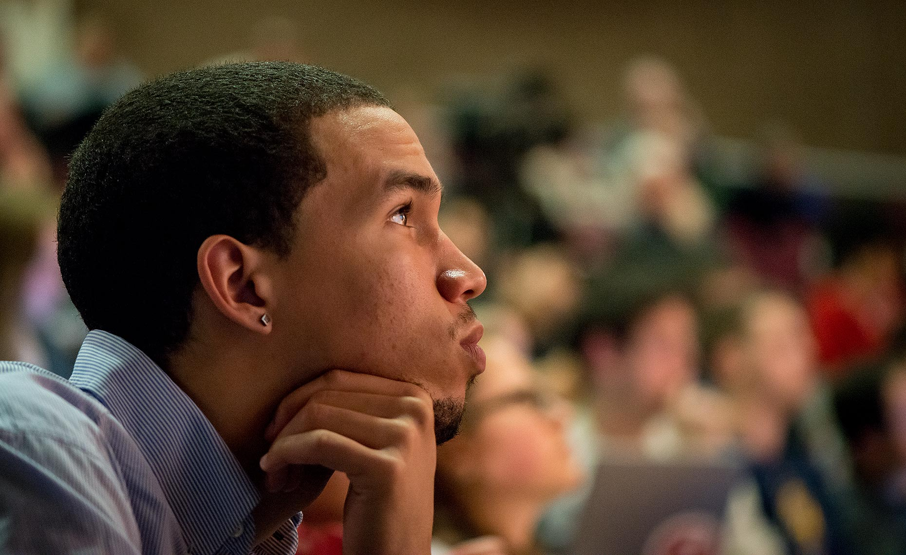 Close up profile of black student in college lecture hall