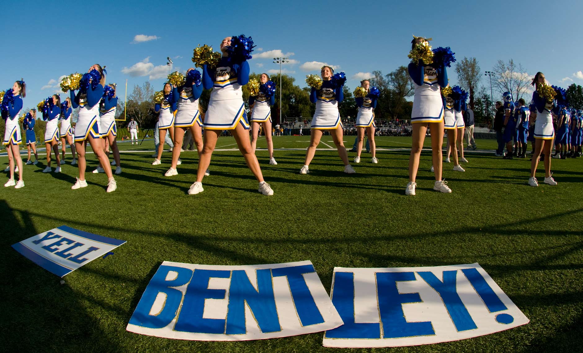 Wide angle photograph of cheerleaders at football game