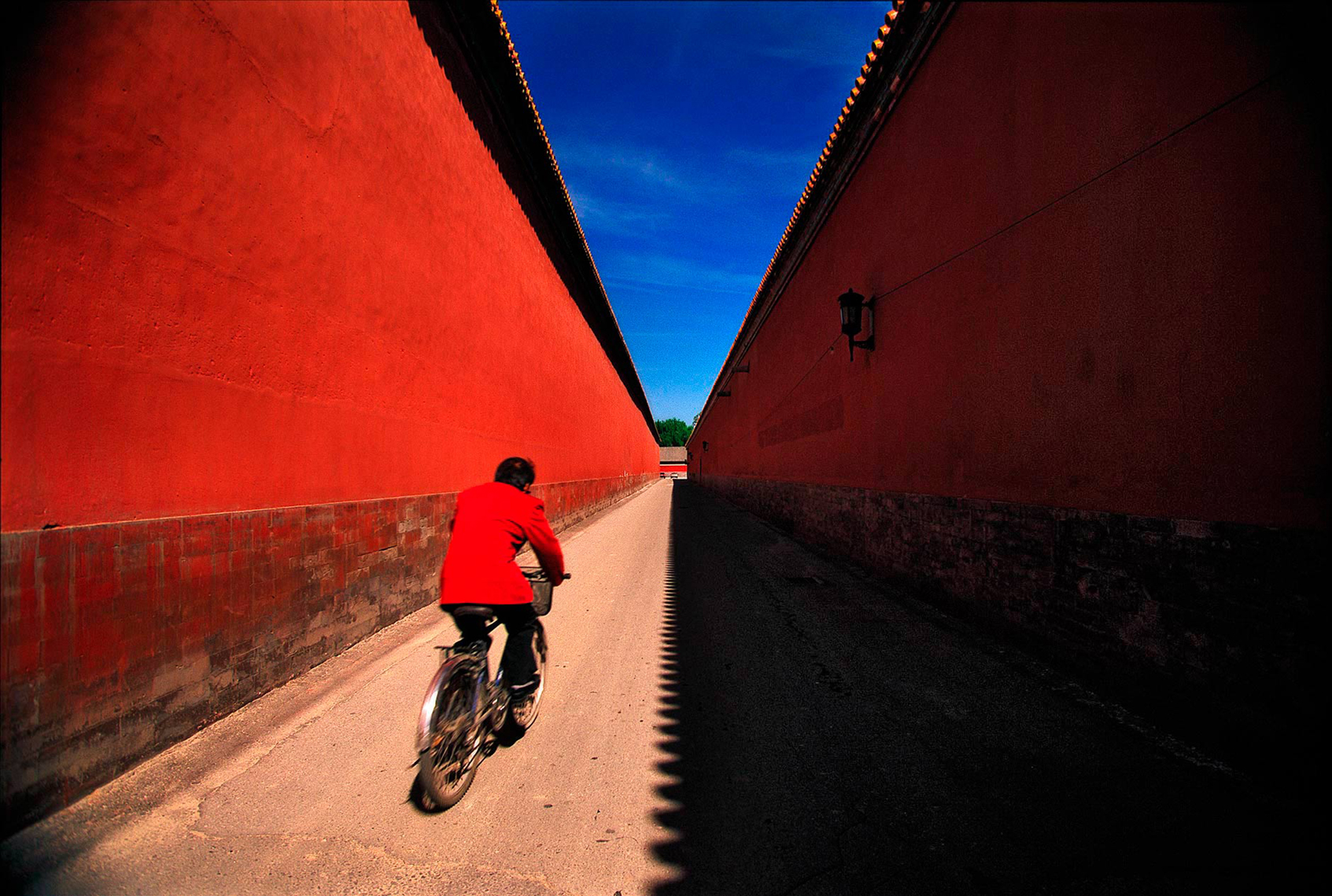 Man riding bicyle inside the Forbidden City, Bejjing China