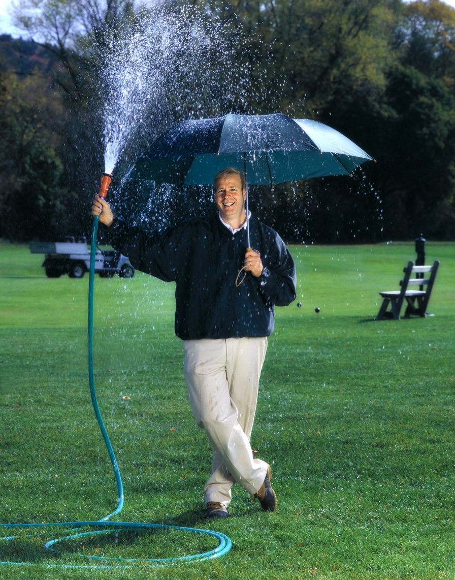 Editorial photograph of a golf course greenskeeper