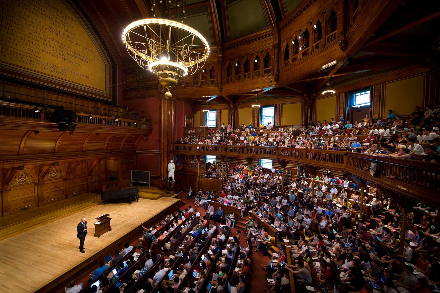 Professor Michael Sandel lecturing at Sanders Theatre in Cambridge, MA