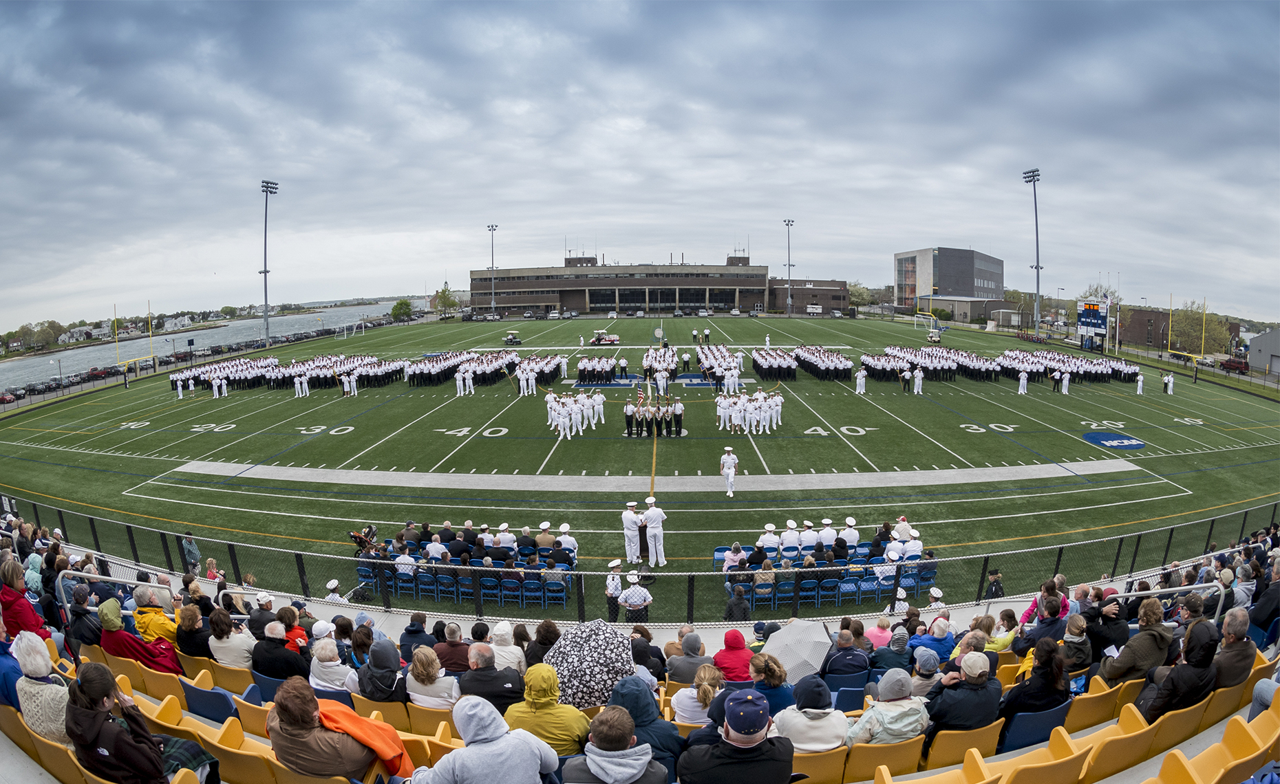 Wide angle photograph showing ceremony held at Mass Maritime Academy