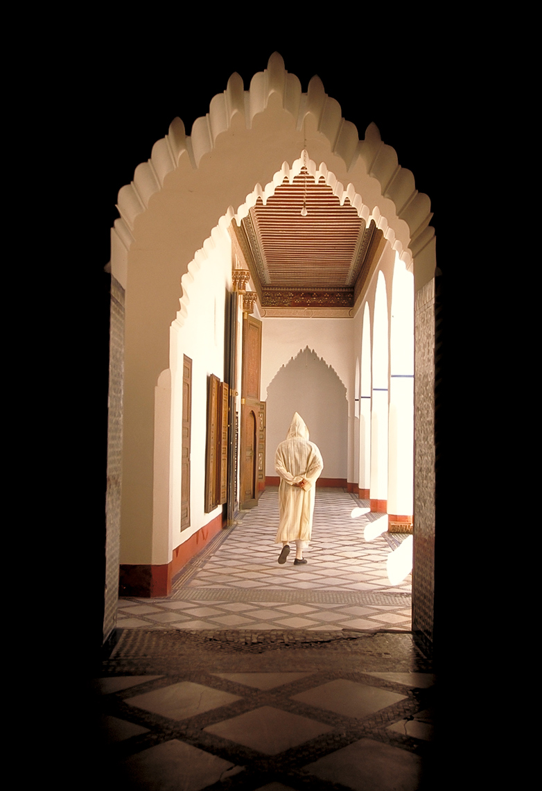 Man walking down hallway in Merrakech, Morroco