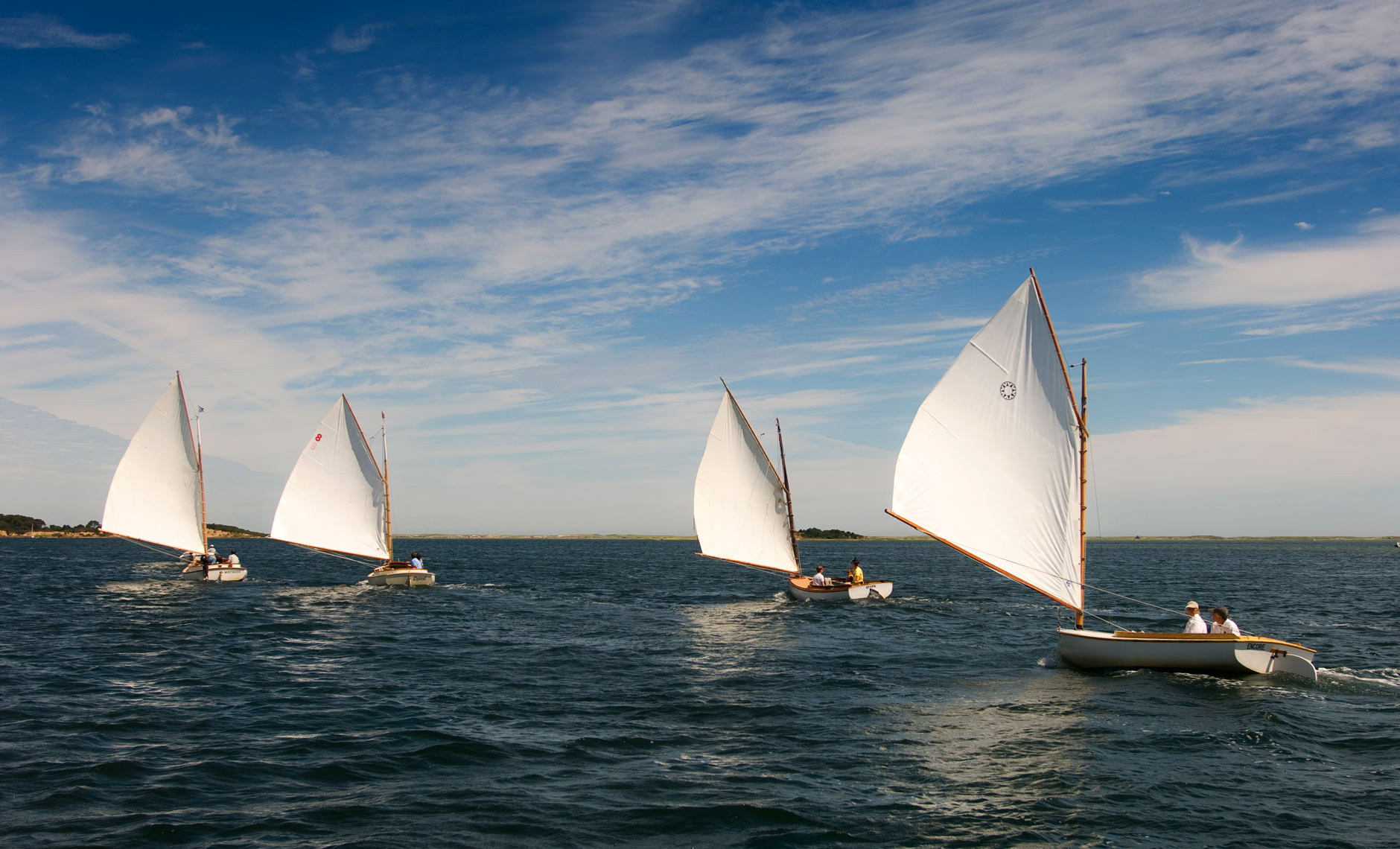 4 small catboats racing in Pleasant Bay Cape Cod