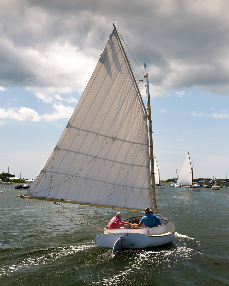 Old wooden catboat named Sarah in Bass River, Cape Cod