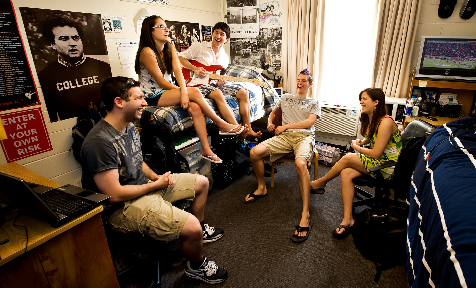 college students hanging out in dormroom at Bentley University