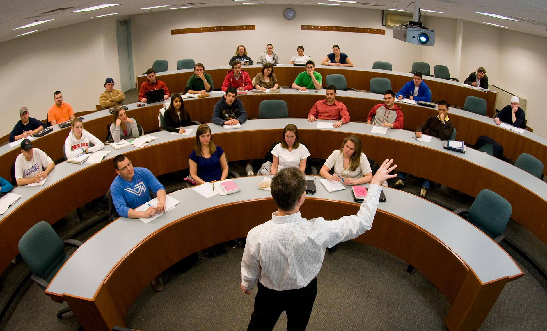 fisheye photograph of professor in college classroom